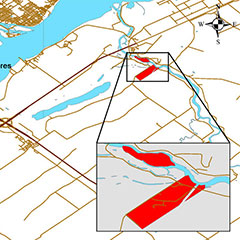 Colour map of the current limits of the Wôlinak community (in red). The St. Lawrence River is also visible.